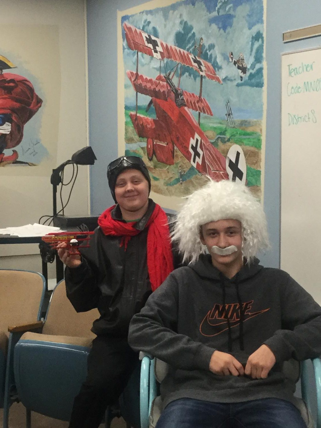 Collin Wilson (left) dressed as the World War I Ace Red Baron and Austin Brandon (right) portraying Albert Einstein.